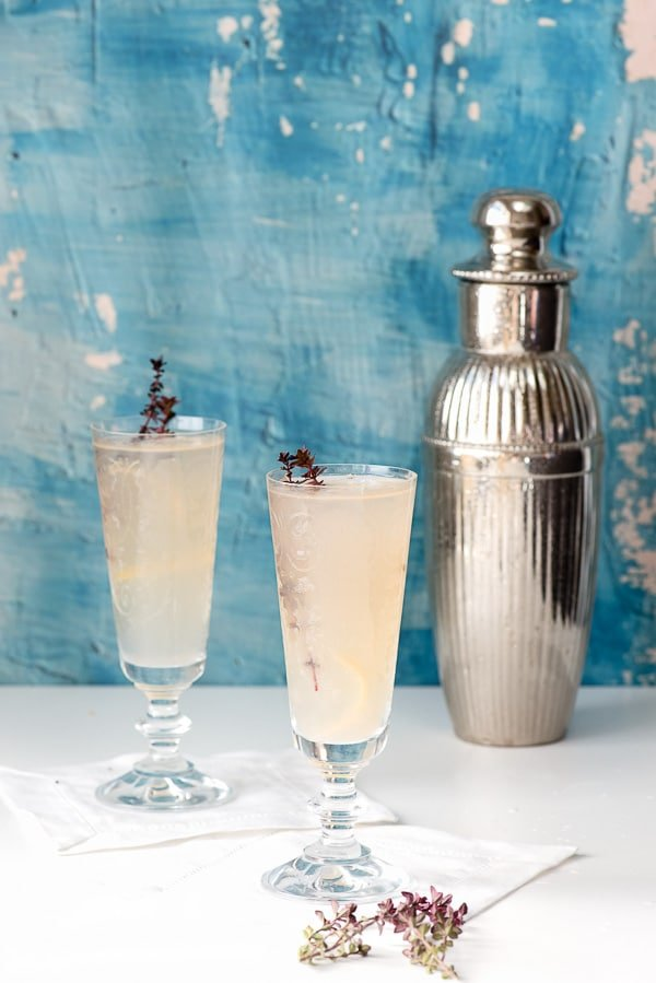 Raspberry Chambord Gin Fizz in glasses with shaker