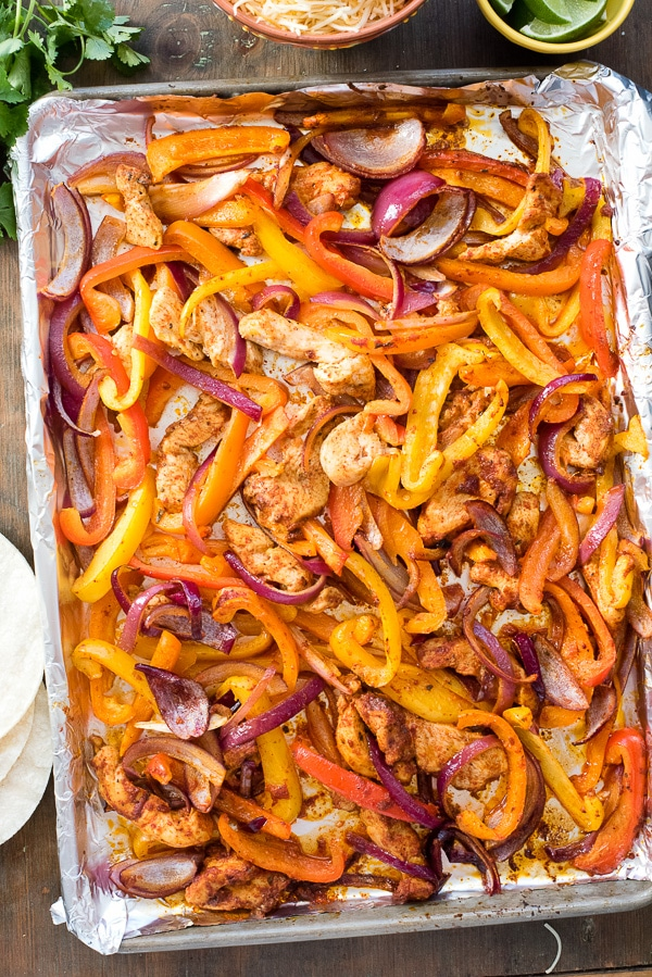 Sheet Pan of chicken fajitas with colorful peppers, onions and chicken