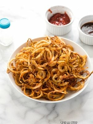 Spiralizer Spicy Baked Curly Fries recipe. A quick, fun recipe for a shared appetizer or side dish. Baked instead of fried for a healthy gluten-free tasty recipe. - BoulderLocavore.com