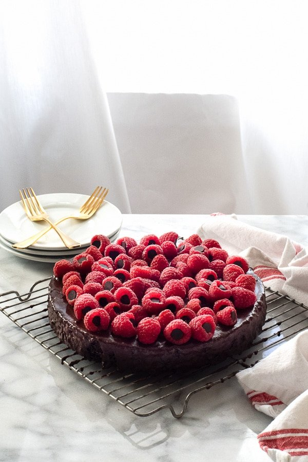 Triple Chocolate Wacky Cake with Chocolate-Stuffed Raspberries (Allergy-Friendly). Fudgy chocolate Wacky Cake with chocolate chips, rich ganache topped with raspberries. Gluten-free, vegan and free of top 8 food allergens! - BoulderLocavore.com