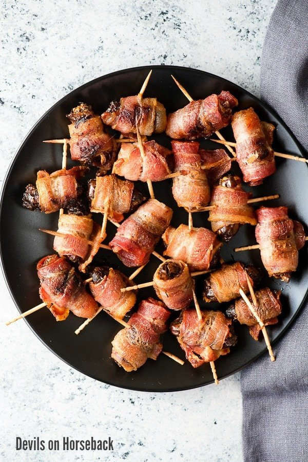 Devils on Horseback appetizer (ingredients). A salty, smoky, sweet hot appetizer made with a smoked almond, inside a date wrapped in bacon. Gluten-free. - BoulderLocavore.com