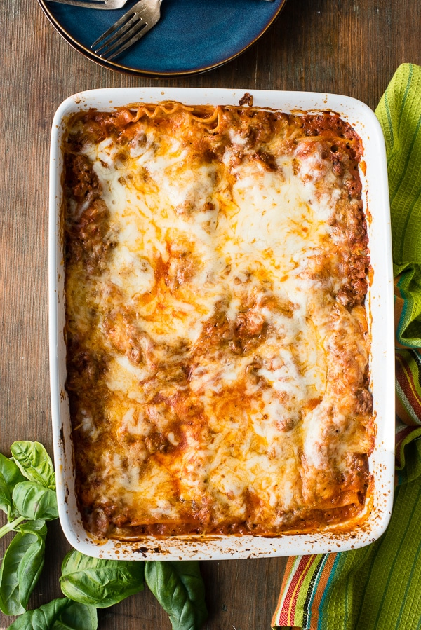 overhead view of cooked pan of meat lasagna with cheesy top