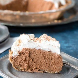Irish Chocolate Silk Pie with Oatmeal Cookie Crust. Rich creamy chocoale and Irish Cream filling in a homey, rustic oatmeal cookie crust! Gluten-free - BoulderLocavore.com