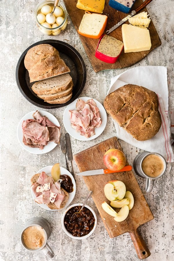 Ploughman\'s Lunch. A simple, rustic British meal of crusty bread, meats, cheese, pickled foods and ale