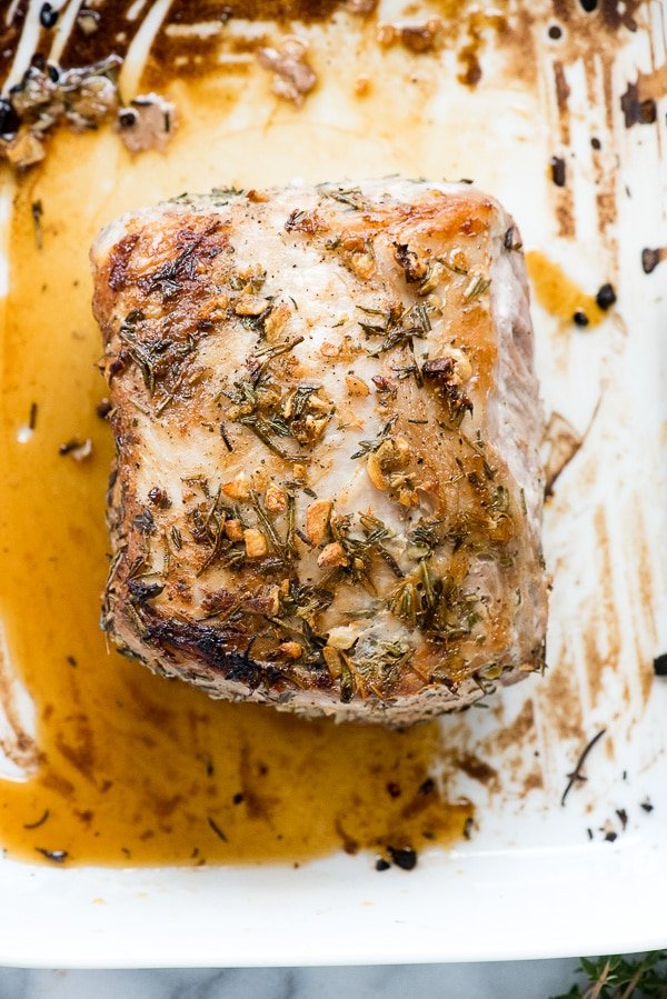 Boneless Pork Loin Roast with Garlic and Herbs. An easy gluten-free recipe, boneless center cut pork loin roast is rubbed with garlic, fresh rosemary and thyme for a juicy roast great for any meal. - BoulderLocavore.com