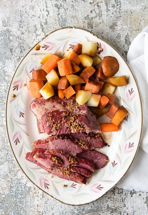 Instant Pot Corned Beef Brisket in Beer with vegetables on a vintage platter