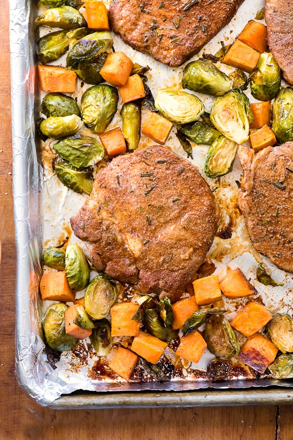 Sheet Pan Spicy Pork Chops wtih Brussels Sprouts and Sweet Potatoes. An easy gluten-free one pan dinner that cooks in 30 minutes! - BoulderLocavore.co