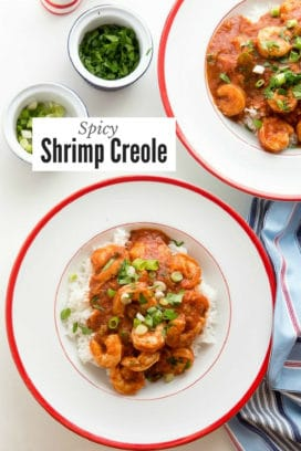 Shrimp Creole over rice in a large white bowl