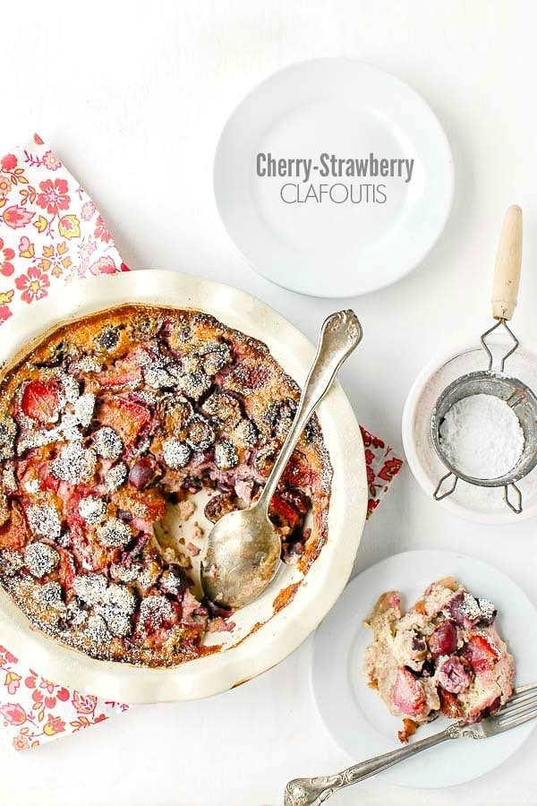 Cherry Strawberry Clafoutis in a pie pan with a single serving