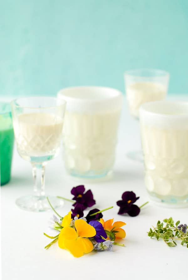 Purple and yellow pansies, fresh thyme sprigs, glasses of rose-flavored panna cotta BoulderLocavore.com
