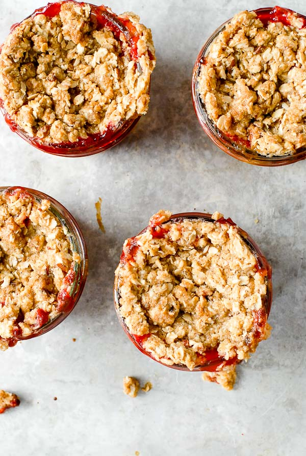 Rolled oat streusel topped strawberry peach Fruit Crumble Jars on galvanized metal tray