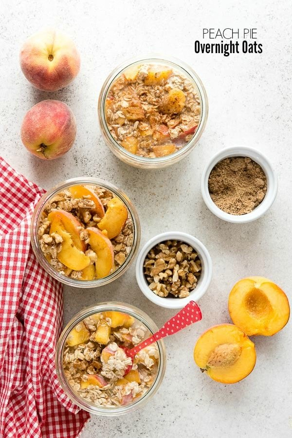 Summery comfort food recipe Peach Pie Overnight Oats in Weck tulip jars with sliced peaches, walnuts and brown sugar and a red check gingham kitchen towel with Sabre spoons BoulderLocavore.com