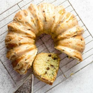 Gluten-Free Zucchini Chocolate Chip Bundt Cake with vintage cooling rack and ornate etched silver cake server