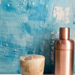 Colorado Bulldog cocktail with copper cocktail shaker and blue distressed plaster wall BoulderLocavore.com