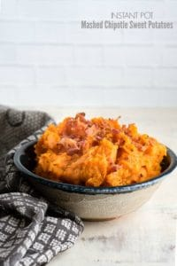 Creamy Instant Pot Mashed Chipotle Sweet Potaotes with Bacon crumbles in a gray glazed ceramic bowl