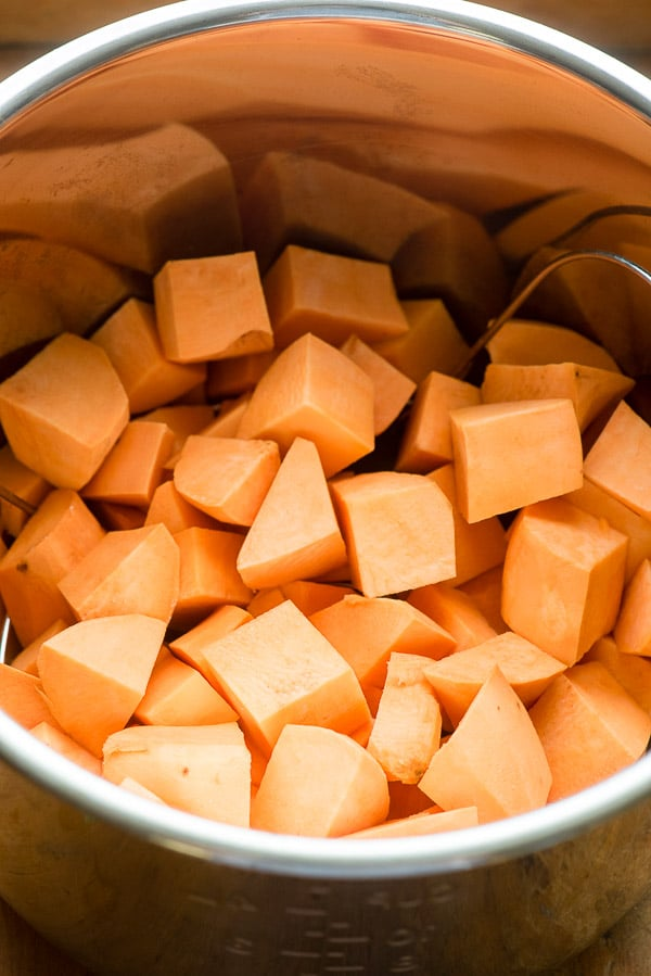 Cubed sweet potatoes in Instant Pot insert for Instant Pot Mashed Chipotle Sweet Potatoes BoulderLocavore.com