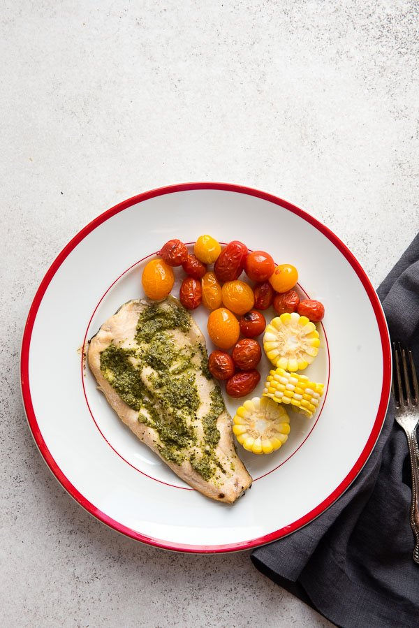 Rainbow Trout with Salsa Verde Sauce with blistered cherry tomatoes and corn rounds LoveTheWild - BoulderLocavore.com