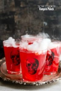 Spooky Slow Cooker Vampire Punch in skull glasses on an antique silver tray