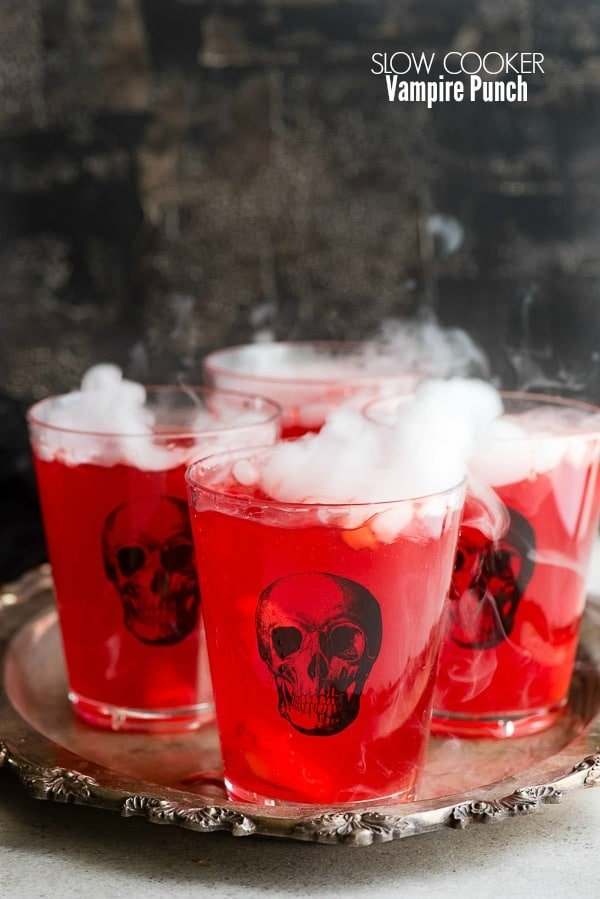 Spooky Slow Cooker Vampire Punch in skull glasses on an antique silver tray BoulderLocavore.com
