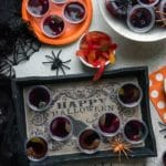 Creepy Halloween Squirm Jello Shots with gummy worms inside on a Halloween tray BoulderLocavore.com