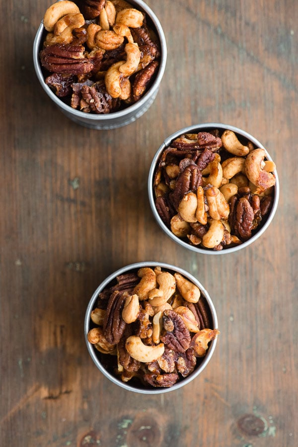 Top view of three galvanized cans of Sweet Spiced Nuts, cashews and pecans in a candied glaze BoulderLocavore.com
