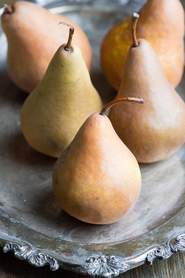 Five Bosc pears on an antique silver platter BoulderLocavore.com