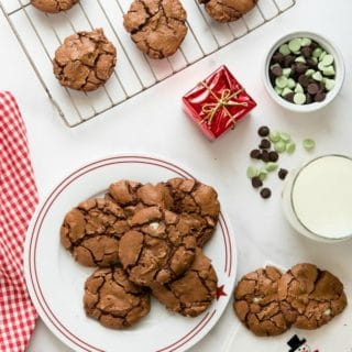Chewy rich Chocolate Mint Truffle Cookies on a white plate with red rim
