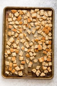 English Muffin cubes on a vintage baking sheet for Gluten-Free English Muffin Sausage Dressing - BoulderLocavore.com