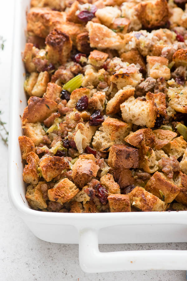 Gluten-Free English Muffin Sausage Dressing in a white baking pan - BoulderLocavore.com