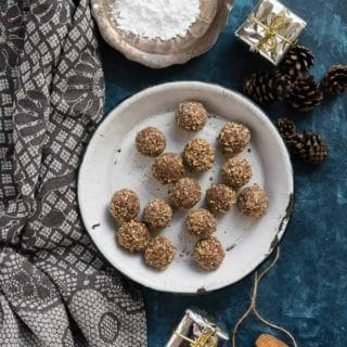 Pecan Rum Balls a no bake holiday treat (in a vintage enamel pie tin, with pine cones, powdered sugar