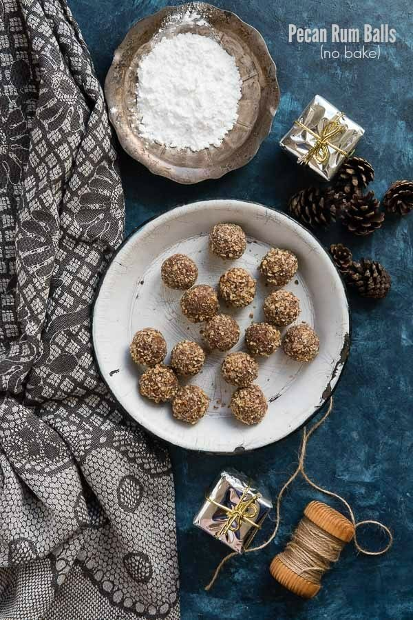 Boozy Pecan Rum Balls a no bake holiday treat (in a vintage enamel pie tin, with pine cones, powdered sugar and gray kitchen towel) BoulderLocavore.com