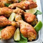 Instant Pot Smoked Paprika & Garlic Chicken Legs with lime wedges on a pewter platter BoulderLocavore.com