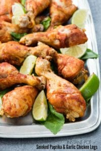 Instant Pot Smoked Paprika & Garlic Chicken Legs with lime wedges on a pewter platter