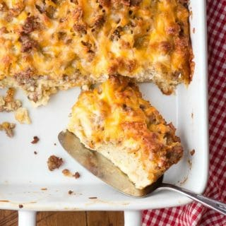 Overnight Gluten-Free English Muffin Breakfast Casserole - single slice in white baking dish