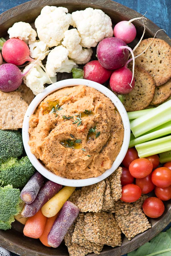 5-Minute Smoked Paprika Garlic Bean Dip with mixed vegetables and crackers