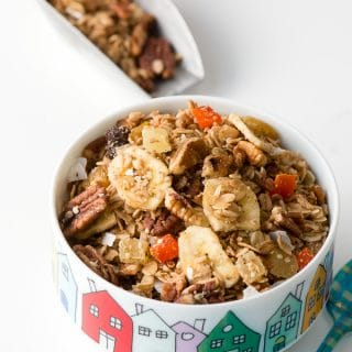 Gluten-free Slow Cooker Tropical Fruit Granola. Crisp (but not hard) homey granola with nuts, seeds and soft pieces of dried tropical fruits. Perfect for breakfast, sprinkling on yogurt or ice cream and more. Gluten option included. - BoulderLocavore.com