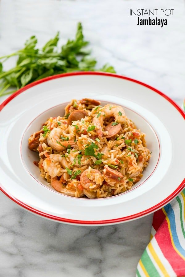 Instant pot jambalaya quick easy comfort food boulder locavore spicy instant pot jambalaya in white bistro bowl wtih red rim and italian parsley forumfinder Images