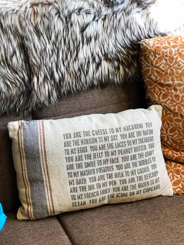 Verse pillow on couch at the Hobbit House