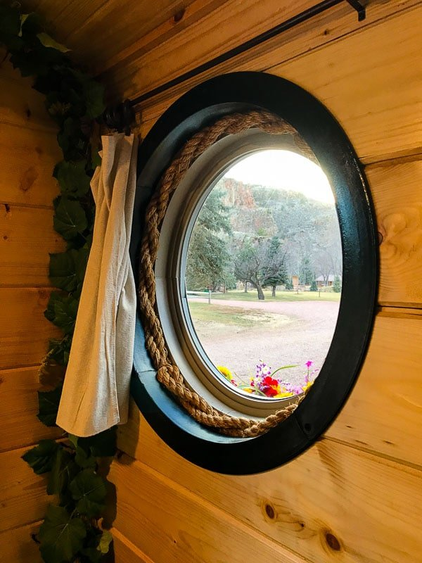 Round window with flower box at the Hobbit House