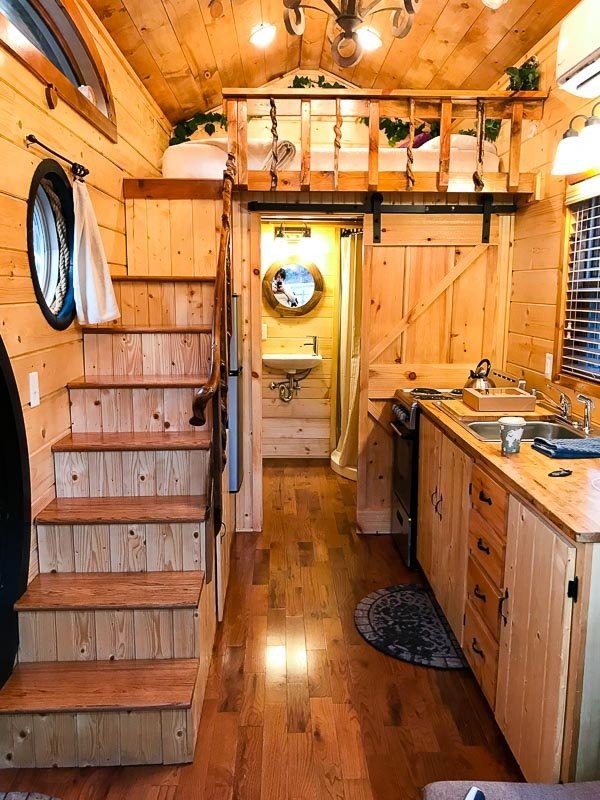Hobbit House Tiny House kitchen, bathroom entrance and sleeping loft