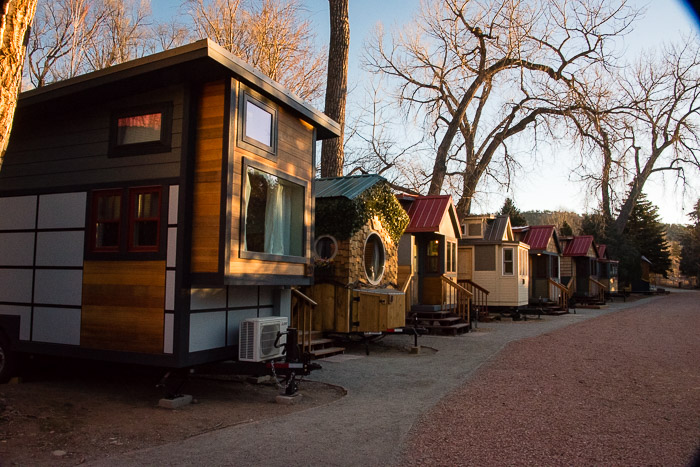 A row of Tiny Houses at WeeCasa Resort Lyons CO at sunrise