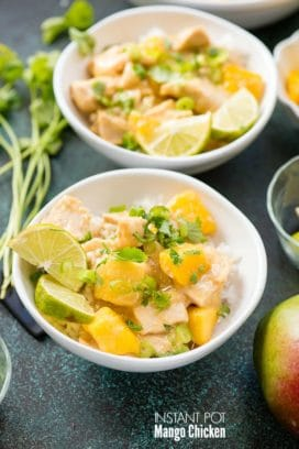 Instant Pot Mango Chicken with cilantro, scallions and lime wedges on rice