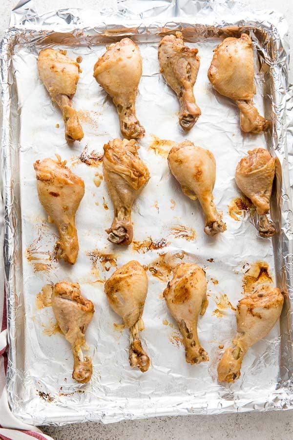 Baking sheet of broiled Instant Pot Ginger Soy Chicken Drumsticks