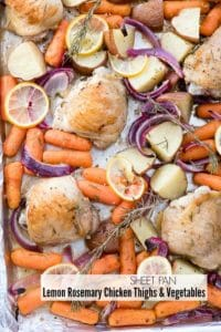 Sheet Pan Lemon Rosemary Chicken Thighs with cooked potatoes, carrots, onions and lemon slices