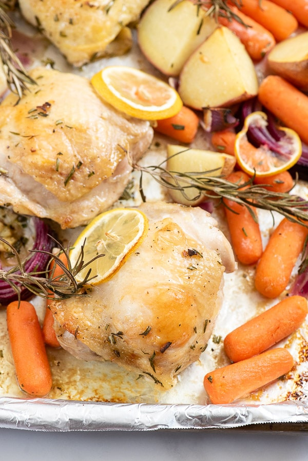 chicken thigh with potatoes, carrots and rosemary