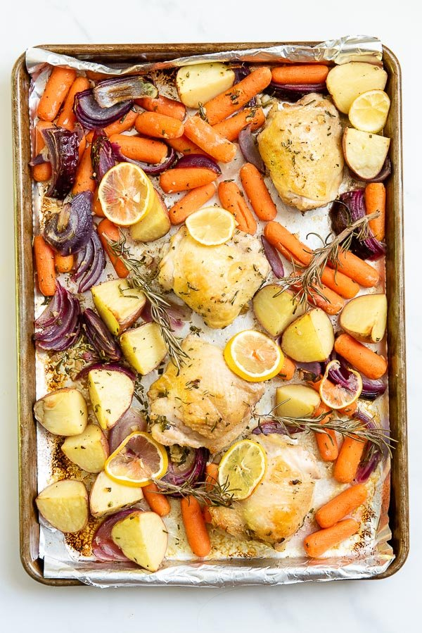 chicken thighs on a sheet pan with vegetables