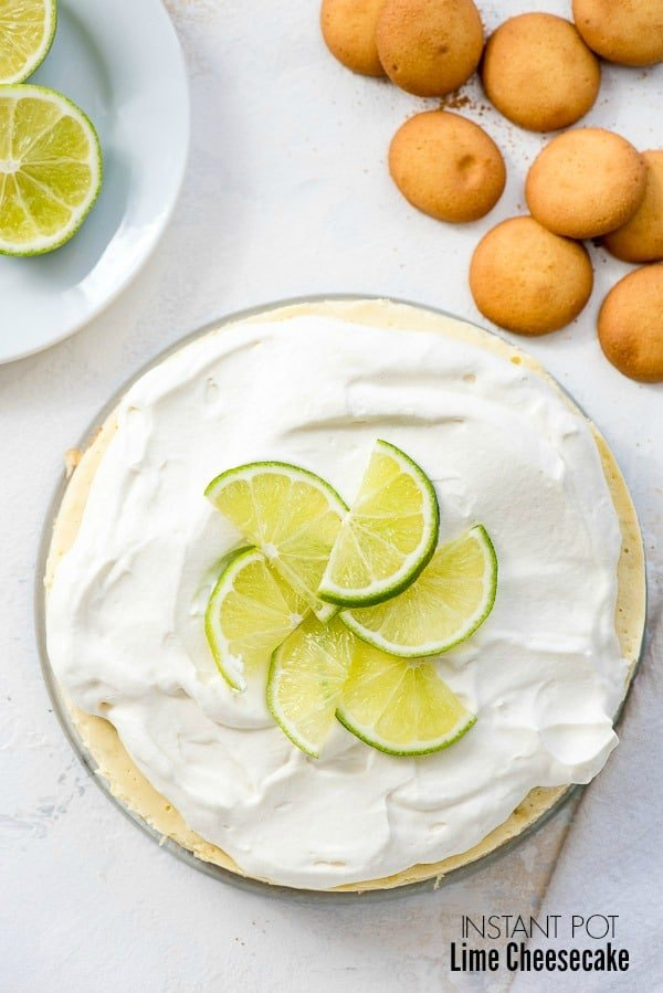 Instant Pot Lime Cheesecake with lime slices on top and gluten-free vanilla wafers