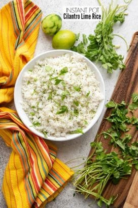 Instant Pot Cilantro Lime Rice in a large white bowl with fresh cilantro and zested limes