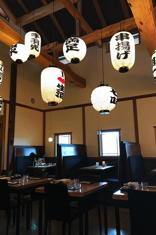Izanami Restaurant at Ten Thousand Waves Santa Fe NM - wooden tables and Japanese lanterns hanging from the ceiling