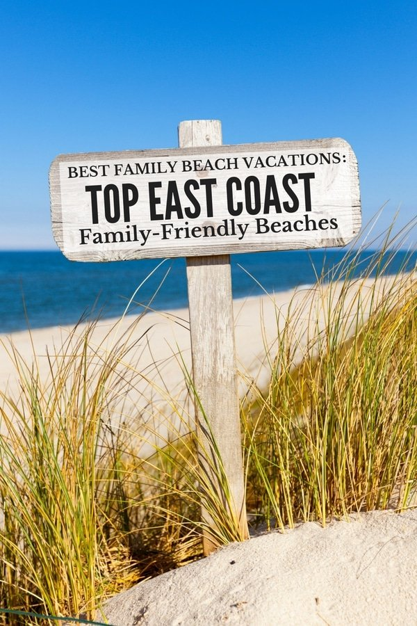 Best East Coast Beaches wooden sign on beach
